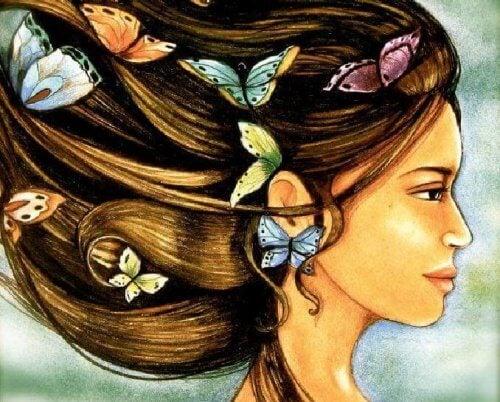 dessin de femme avec des papillons dans les cheveux