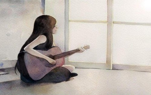 Femme-avec-une-guitare-assise-sur-le-sol