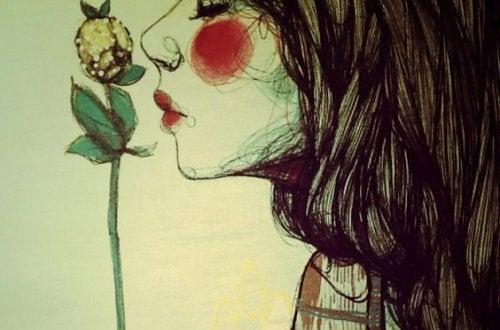femme-sentant-une-fleur-500×330