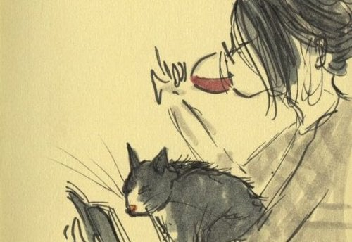 Femme buvant du vin avec son chat.