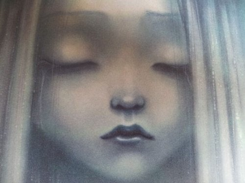 Fille-triste-yeux-fermes-500x375