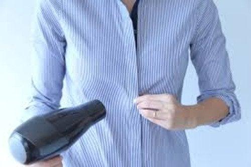 sécher ses vêtements avec un séchoir