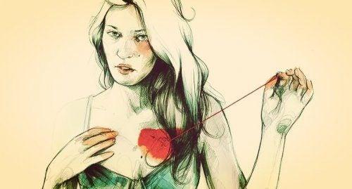 mieux vaut être seul que mal accompagné femme qui se touche le coeur
