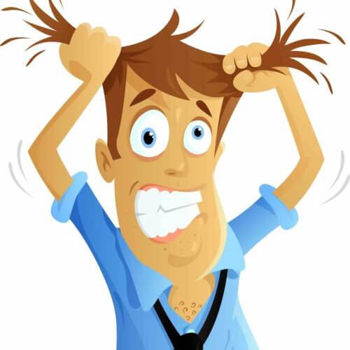 Un homme qui se tire les cheveux du stress.